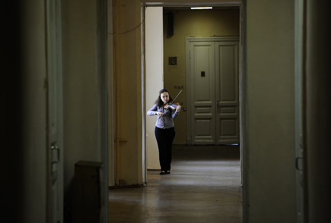The Moscow Conservatory is a higher musical education institution. Photo: A student plays the violin at the corridor of the conservatory, 2010