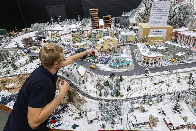 A worker of the Grand Maket Russia museum prepares a miniature version of Russia
