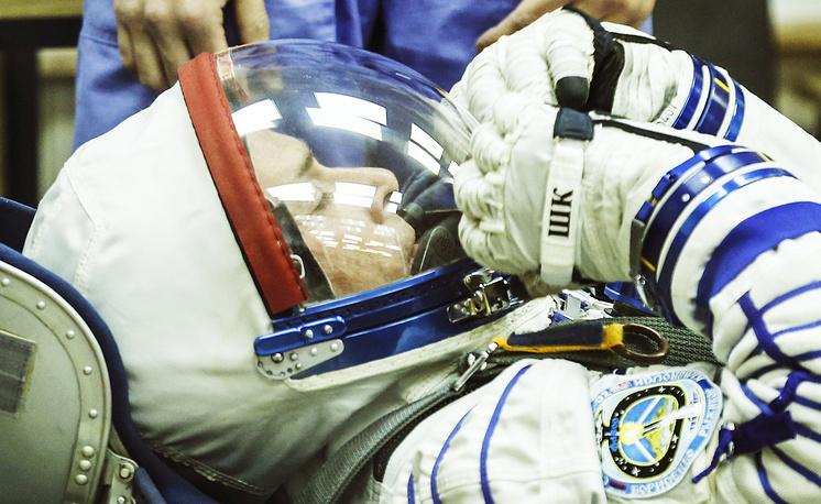 US austronaut Shane Kimbrough at a spacesuit check