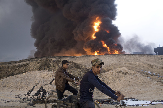 A burning oil well in Qayara, outside Mosul