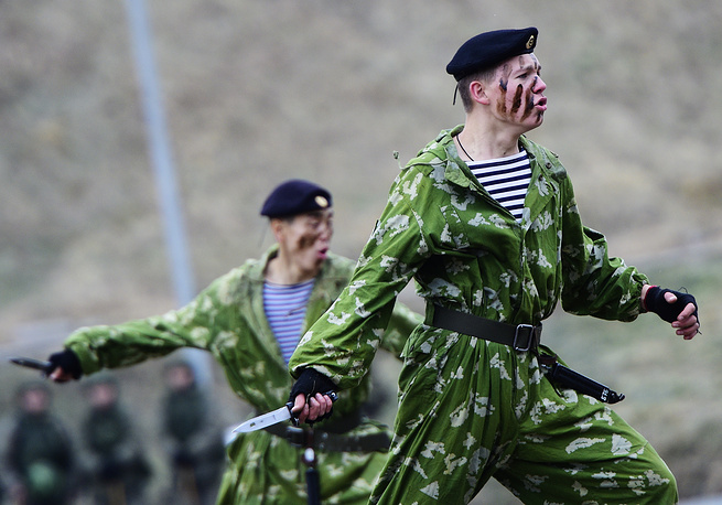 Russian marines perform during a military show marking the 311th birthday of the Russian Naval Infantry