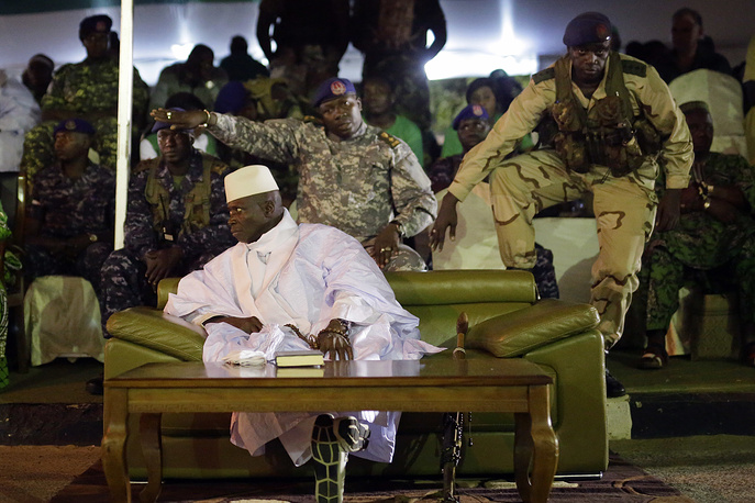 Gambian officers seen behind President Yahya Jammeh at a campaign rally in Banjul, Gambia, November 29