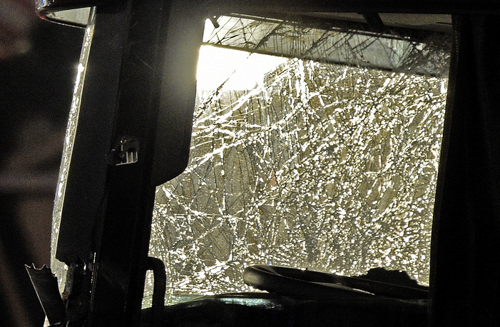 The damaged front part of a truck