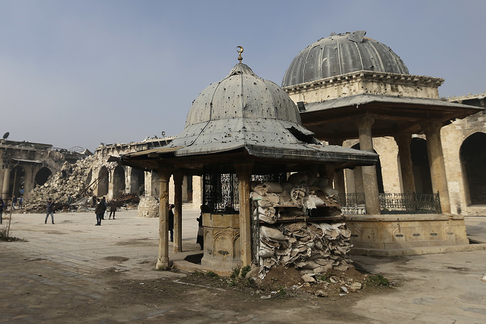 A centuries-old Umayyad Mosque today is a grim monument to the ravages of Syria's war. Its walls were shredded by bullets and minaret was toppled and shattered. Photo: Damage inside the Great Mosque of Aleppo, in the Old City of Aleppo
