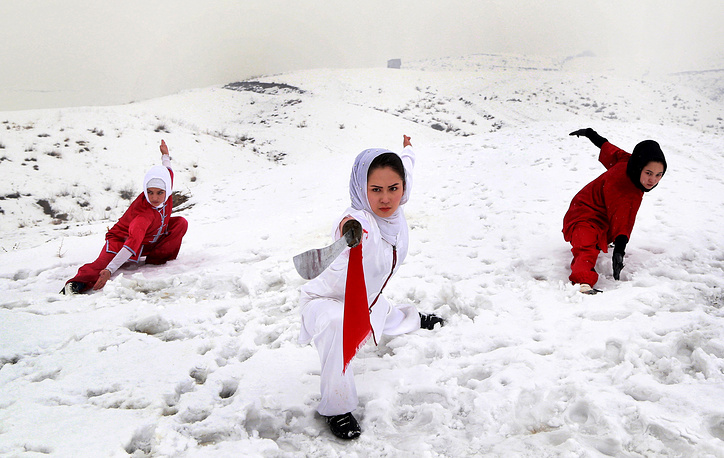 Afghan girls from 'Shaolin Wushu Club' practice their skills during a training session, on the top of a hill in Kabul, Afghanistan, January 25