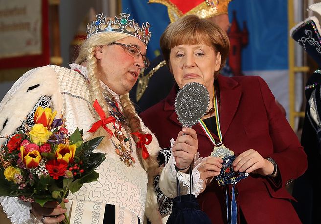 German Chancellor Angela Merkel meets a Carnival delegation during the annual Carnival reception at the Chancellery in Berlin, January 23