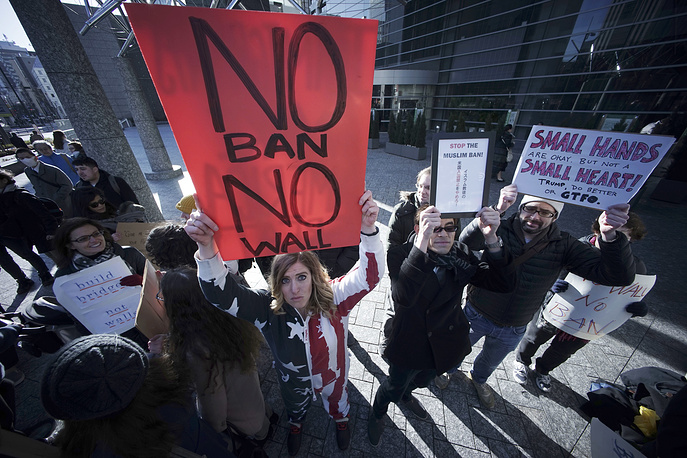 Americans and other expatriates gather to protest US President Donald Trump's recent travel ban outside of the US Embassy in Tokyo, January 31