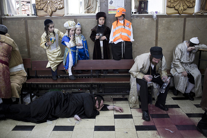 Ultra-Orthodox Jewish men celebrate the holiday of Purim in the Mea Shearim neighborhood of Jerusalem, Israel, March 13