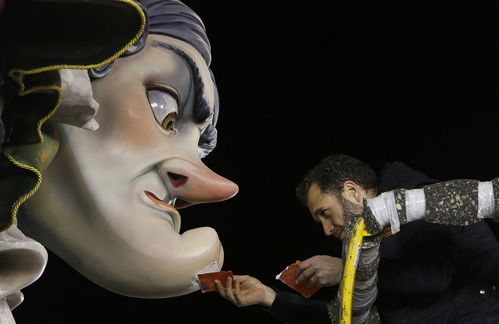 A worker makes final adjustments on a Falla before the start of the traditional Fallas festival in Valencia, Spain, March 15