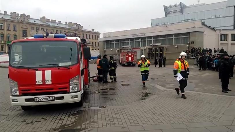 Emergency services work outside Sennaya Square metro station in St. Petersburg, Russia