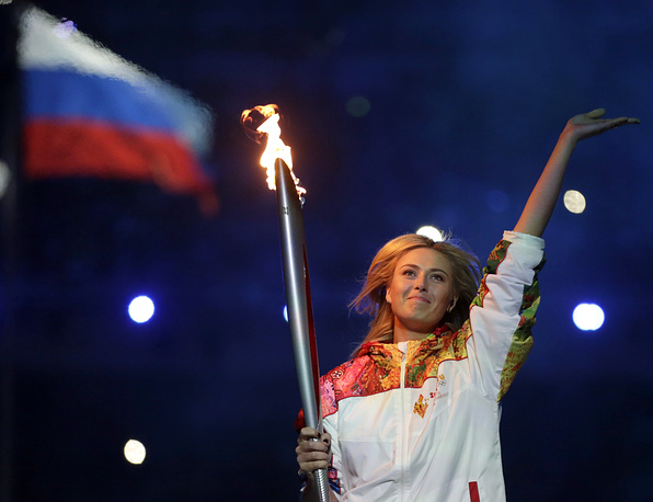 Russia's Maria Sharapova carries the torch during the opening ceremony of the 2014 Winter Olympics in Sochi, Russia, 2014