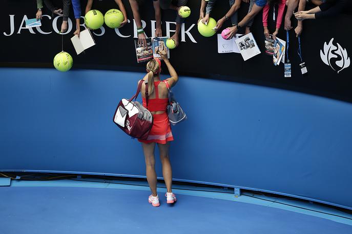 Maria Sharapova  signs autographs after winning a match at the Australian Open Grand Slam tennis tournament in Melbourne, Australia, 2015