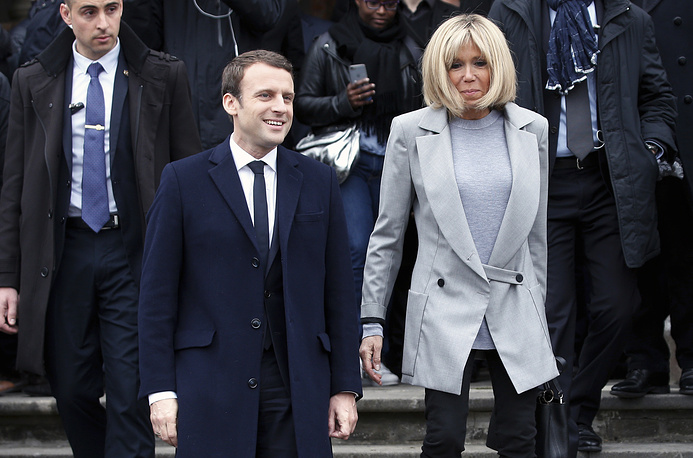 Emmanuel Macron and his wife Brigitte leave after casting their ballot in le Touquet