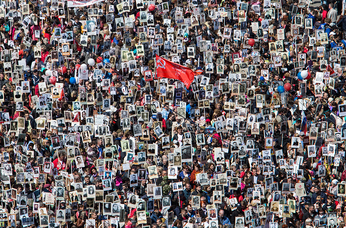 People take part in an Immortal Regiment memorial event marking the 72nd anniversary of the Victory over Nazi Germany in the 1941-1945 Great Patriotic War, the Eastern Front of World War II, May 9