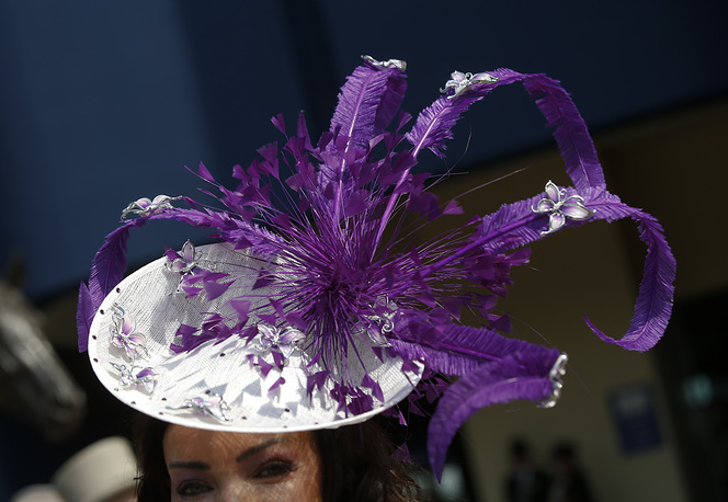 A racegoer in an ornate hat at the Royal Ascot horse race