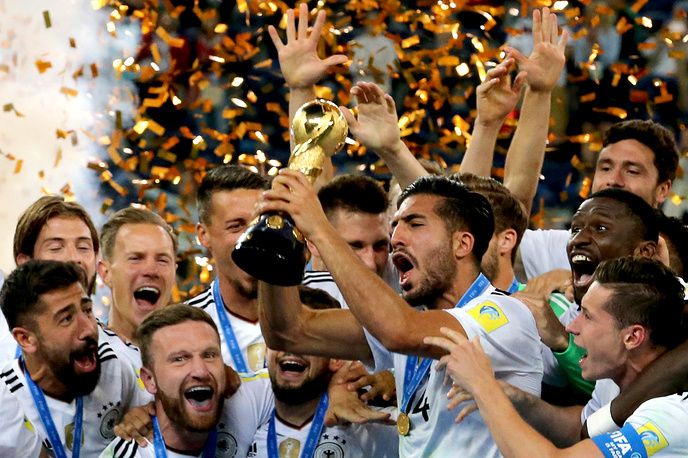 Germany's Emre Can holds the trophy as he celebrates with his teammates after winning their 2017 FIFA Confederations Cup final football match against Chile at Saint Petersburg Arena Stadium, Russia, July 2