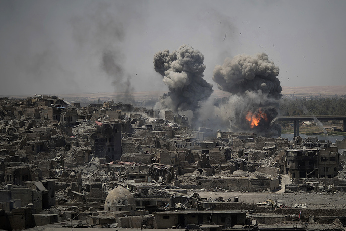 "Airstrikes target Islamic State positions on the edge of the Old City a day after Iraq's prime minister declared ""total victory"" in Mosul, Iraq, July 11"