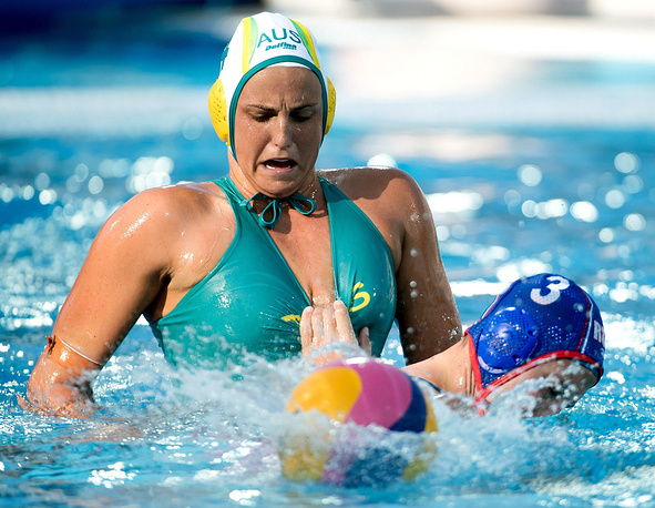 Bronte Halligan of Australia in action against Ekaterina Prokofyeva of Russia during the women's water polo Group D match between Australia and Russia