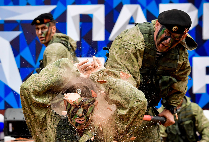 Servicemen of the Russian Pacific Fleet's Naval Infantry perform at the opening of Vladivostok's Patriot Park at the Voroshilov Coastal Battery memorial complex on Russky Island, Russia, July 22