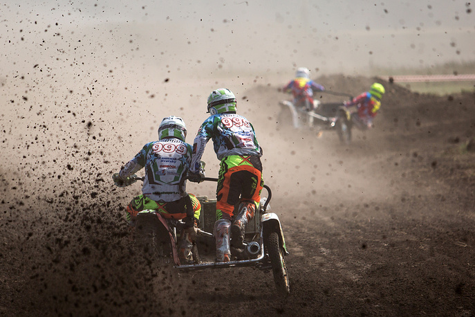 The fourth stage of the Russian motocross championship on motorcycles with carriages in the village of Tavricheskoye, Russia, August 6