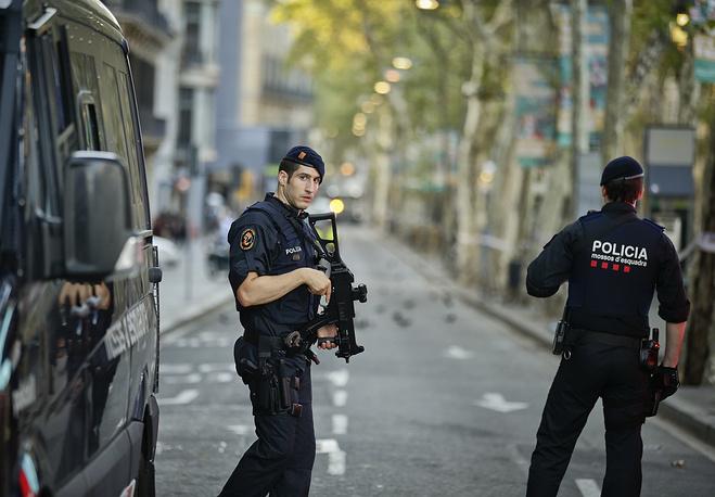 Armed police officers patrol a street in Las Ramblas, Barcelona