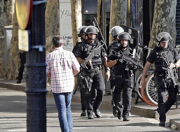 A manhunt near the site where a van crashed into pedestrians in Las Ramblas, Barcelona