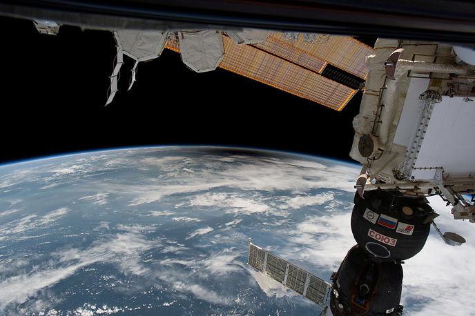 The ISS hovers over Earth capturing an image of the solar eclipse's shadow falling on the planet's surface, August 21