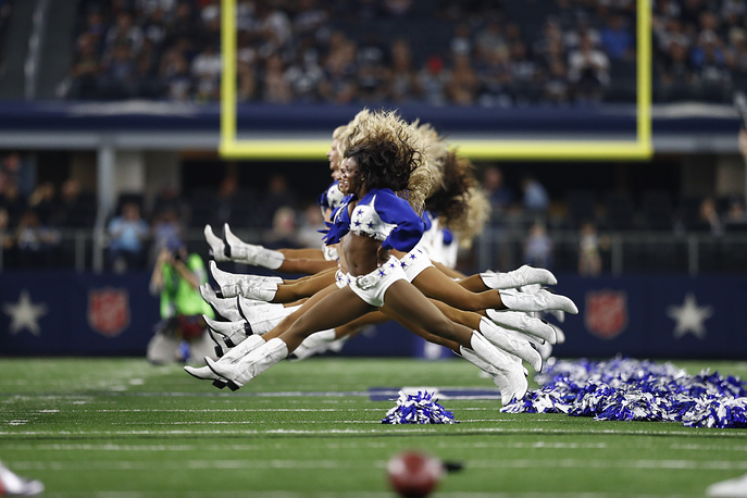 Dallas Cowboys cheerleaders perform before the NFL American football pre-season game between the Oakland Raiders and the Dallas Cowboys in Arlington, Texas, USA, August 26