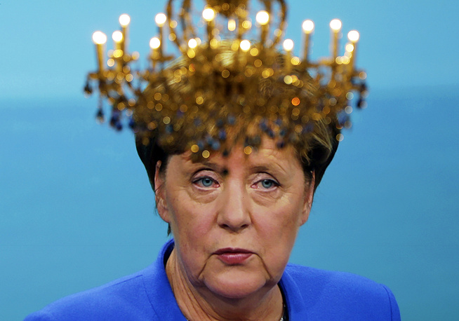 """Merkel's """"crown"""" - a chandelier dangles in front of the screen showing German Chancellor Angela Merkel during the only TV debate between her and Social Democratic Challenger Martin Schulz before the parliamentary election in Berlin, September 3"""