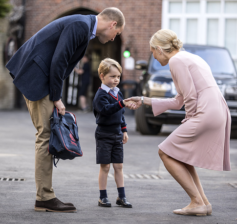 Britain's Prince William accompanies Prince George as he is greeted by Helen Haslem - the head of the lower school upon arrival for his first day at Thomas's school in Battersea, London, September 7