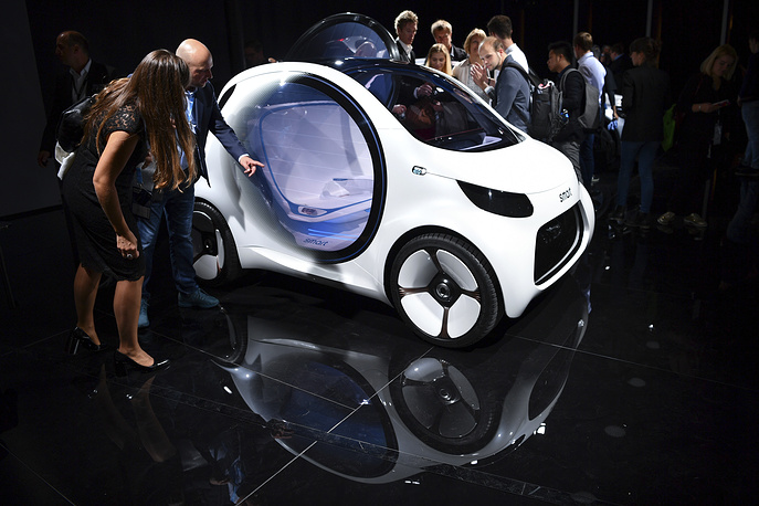 Visitors stand next to a Smart 'Vision EQ'