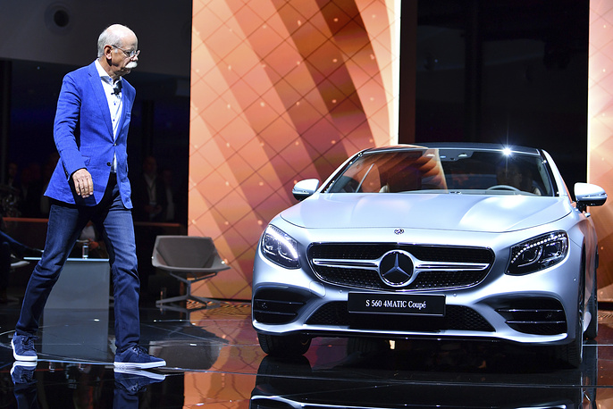 Daimler CEO Dieter Zetsche walks past a Mercedes S560 4Matic Coupe
