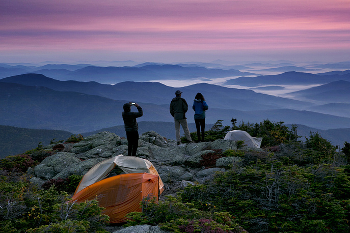 Tourists take photographs before sunrise from their campsite on the Appalachian Trail in Beans Purchase, USA, September 17