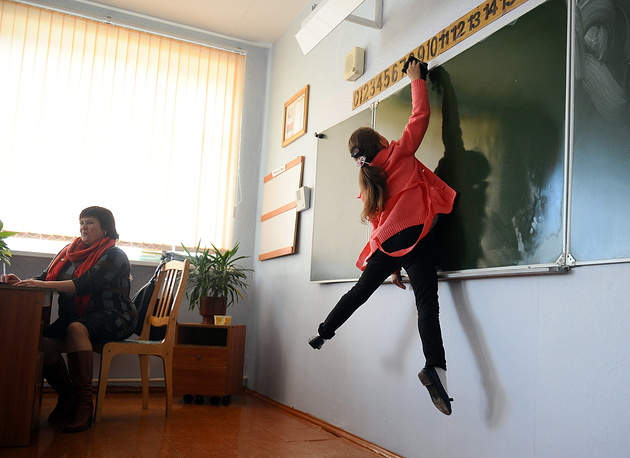 A pupil washes the blackboard at the Kolno village school ahead of International Teachers' Day celebrated on October 5 in Gomel region, Belarus, October 4