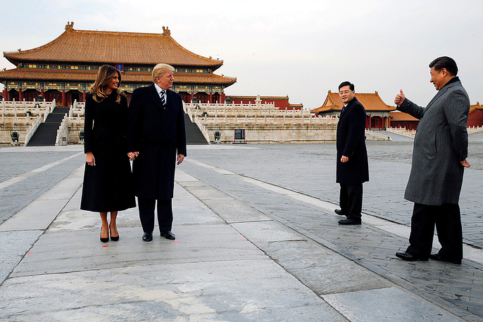 Donald Trump, his First Lady Melania Trump and China's leader Xi Jinping during a walk in the Forbidden City, Beijing, November 8
