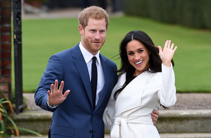 Britain's Prince Harry and Meghan Markle pose for the media on the grounds of Kensington Palace in London, November 27