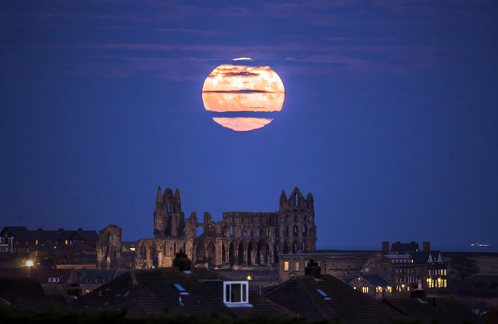 Supermoon rises above Whitby Abbey in Whitby, north east England