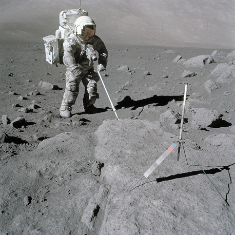 Scientist-astronaut Harrison Schmitt, Apollo 17 lunar module pilot, uses an adjustable sampling scoop to retrieve lunar samples at the Taurus-Littrow landing site on the moon