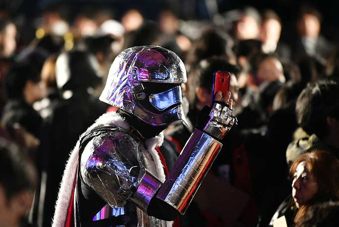 A fan wearing a Captain Phasma costume takes pictures during the red carpet event of the upcoming movie 'Star Wars: The Last Jedi' in Tokyo, Japan, December 6