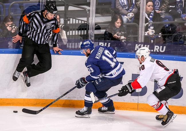 HC Dynamo Moscow's Denis Kokarev and HC Traktor Chelyabinsk's Konstantin Klimontov fight for the puck in their 2016/2017 KHL Regular Season ice hockey match at VTB Ice Palace, Moscow, January 23