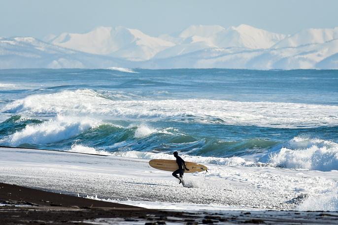 A surfer on the Avachinsky Bay coast, February 26