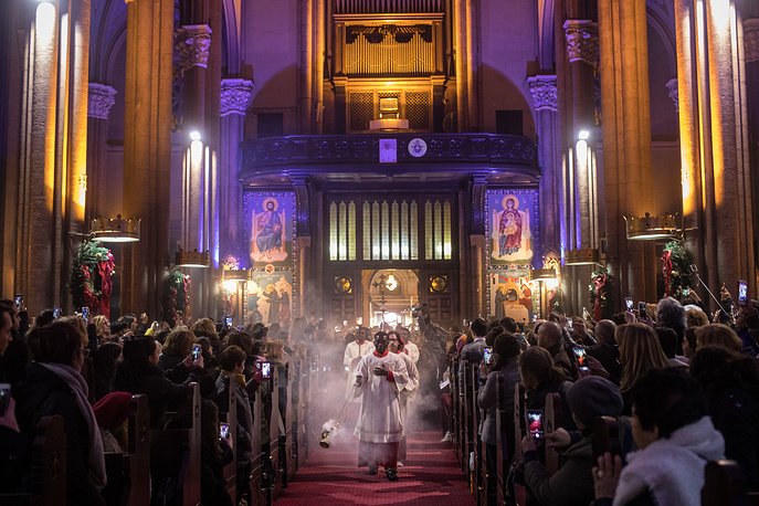 People attend Christmas Eve mass at the Saint Anthony of Padua Church in Istanbul, Turkey, December 24