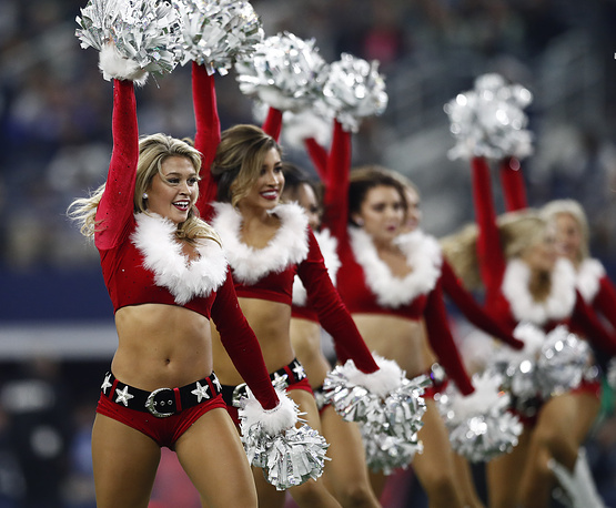 Dallas Cowboys cheerleaders perform during halftime in the second half of the NFL American football game between the Seattle Seahawks at Dallas Cowboys at the AT&T Stadium in Arlington, USA, December 24