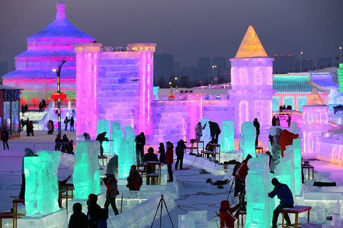 Participants carve their ice sculptures
