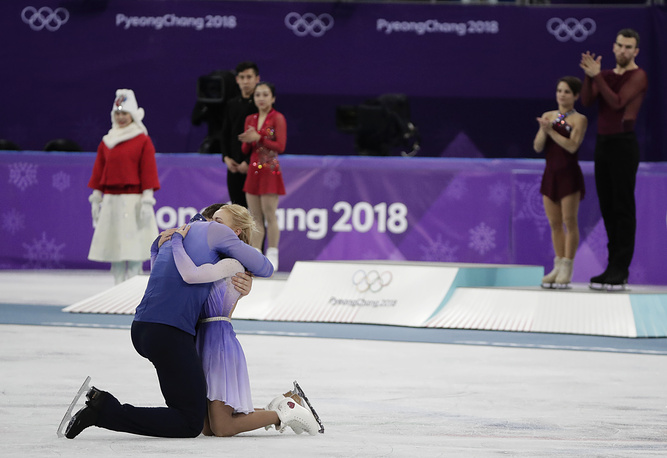 Aljona Savchenko and Bruno Massot of Germany embrace as they celebrate during the venue ceremony after winning the gold medal in the pairs free skate figure skating final at the 2018 Winter Olympics in Gangneung, South Korea, February 15