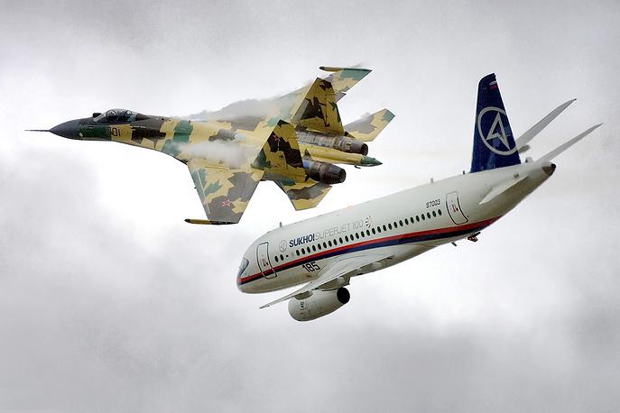 Sukhoi Su-35 fighter jet and Sukhoi Superjet 100 plane