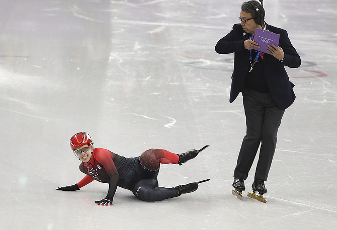 Marianne St-Gelais of Canada falls during women's short track speed skating 1500m semifinals