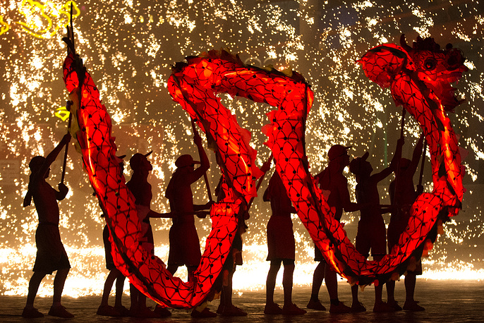 Artists perform a traditional dragon dance under sparks from molten iron during the Chinese Lunar New Year celebrations at Happy Valley, in Beijing, China, February 20