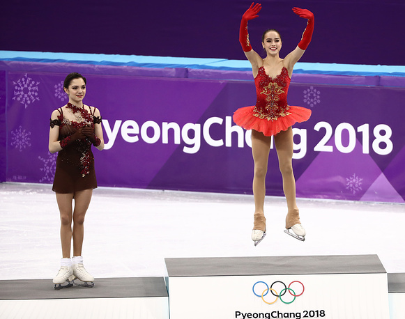 Evgenia Medvedeva and Alina Zagitova pose at a flower ceremony for the ladies' figure skating event at the Gangneung Ice Arena