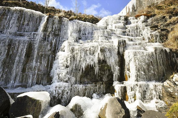 Icicles formed on a frozen waterfall near Pen y Fan mountain in Brecon Beacon National Park, Wales